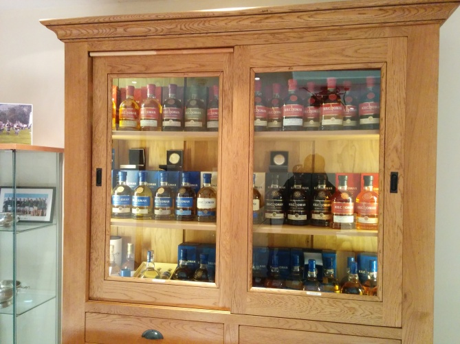 The cabinet within the distillery store which showcases every release from Kilchoman to date.
