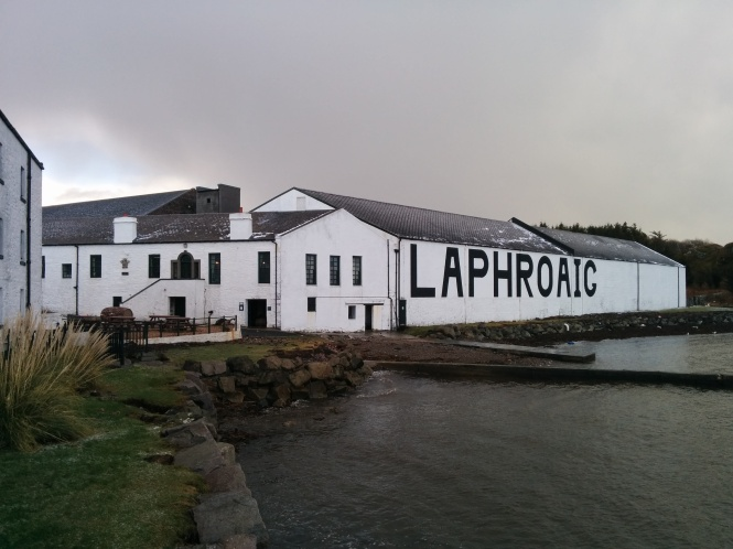 The large black lettering on the side of the warehouse closest to the water. It is so prominent that it can be seen from on board the ferries departing from and arriving in Islay.